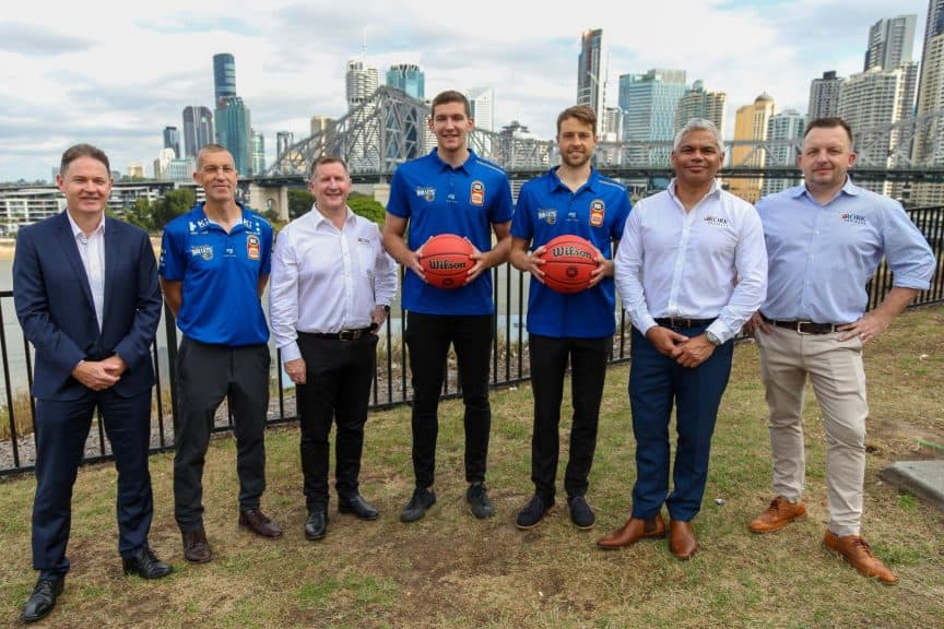 Brisbane Bullets and Rork Projects executive announce the new sponsorship deal, with players Will Magnay and Nathan Sobey